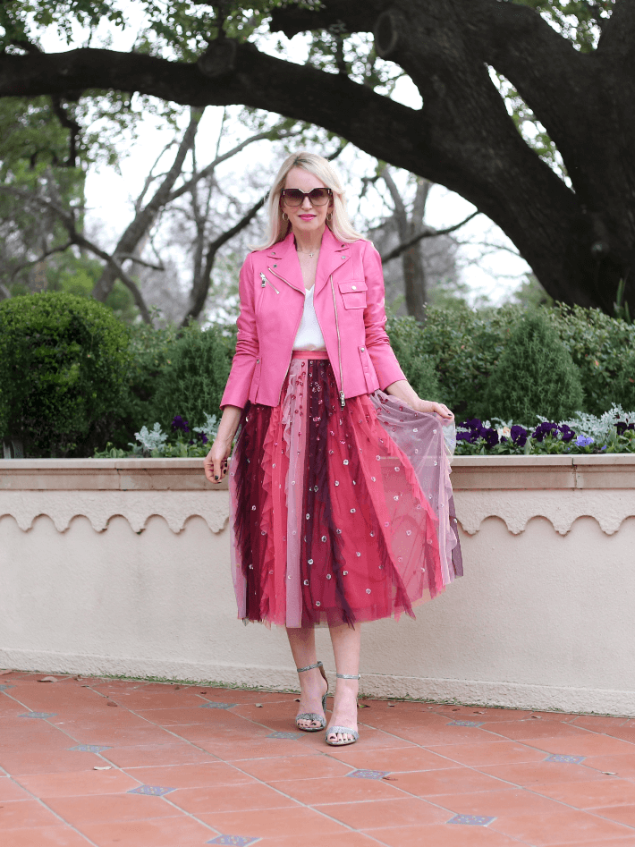 Dallas style blogger 'Truly Megan' wears pink tulle skirt and pink leather moto jacket perfect for a Valentine's Day outfit.