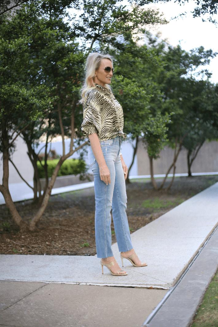 Dallas fashion blogger Megan Saustad wearing Topshop zebra print top, Frame jeans and Schutz Ariella transparent heels.