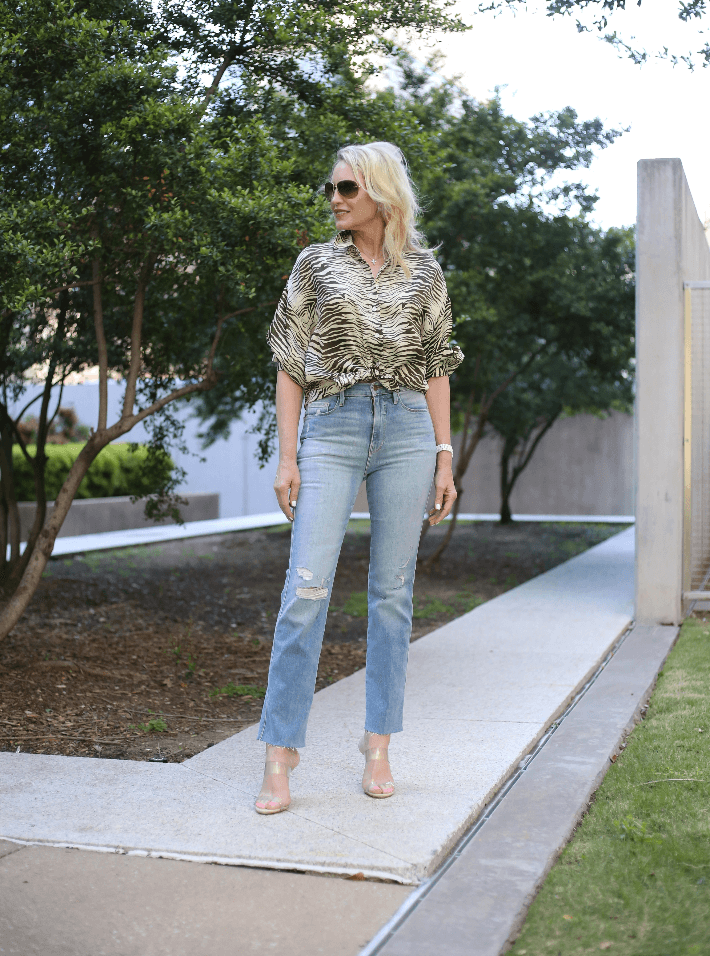 Dallas blogger Truly Megan wearing Topshop Zebra print blouse and Frame jeans.