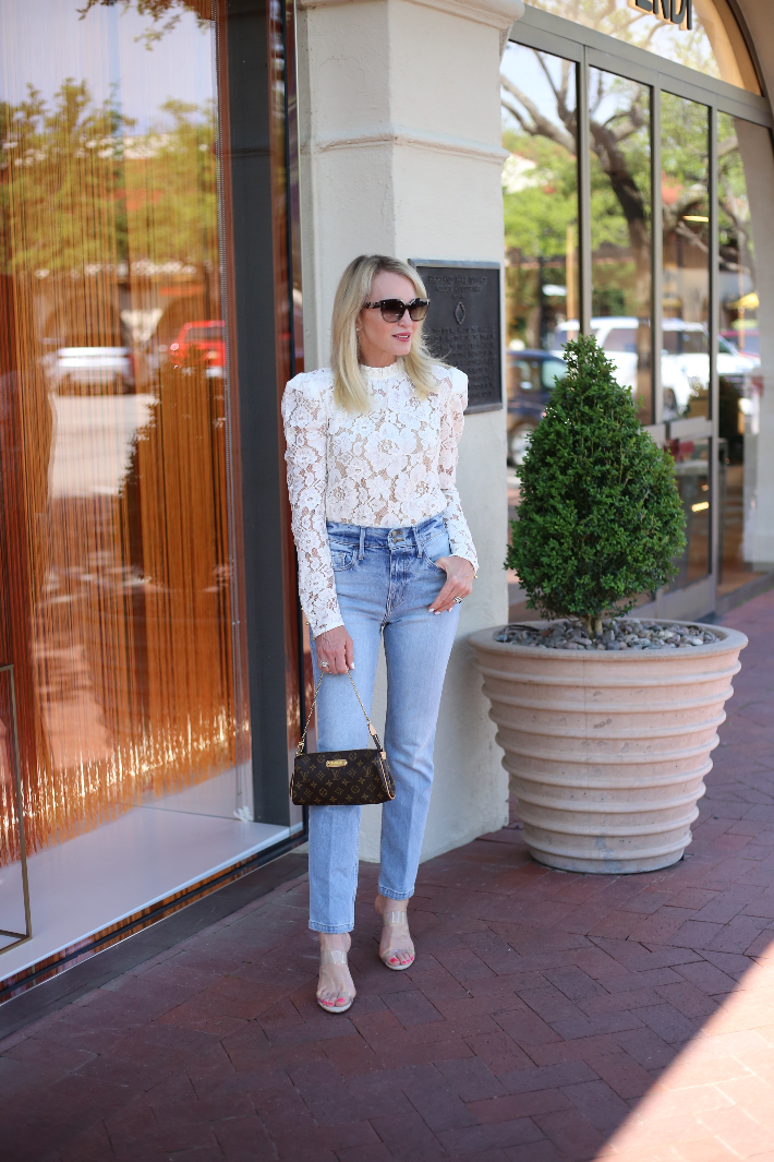 Dallas blogger Megan Saustad wearing WAYF white lace blouse with Frame jeans and carrying Louis Vuitton Eva clutch.