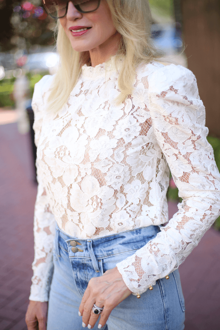 Dallas style blogger Truly Megan wears white lace blouse by WAYF.