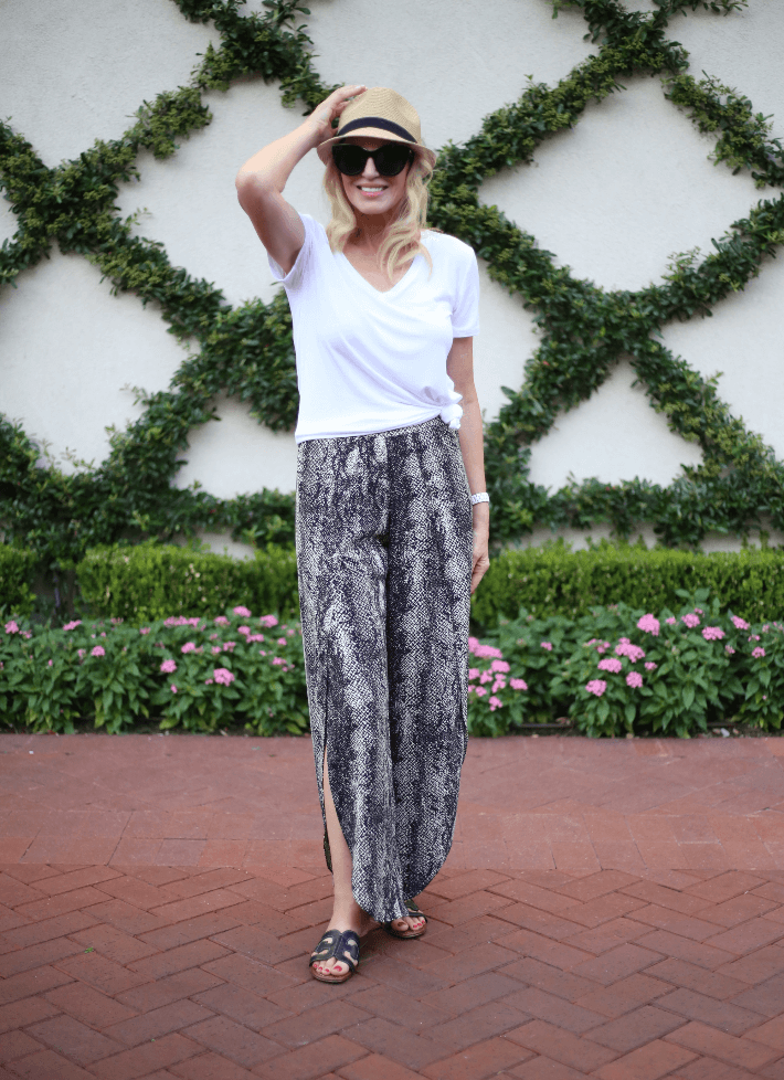 Dallas style blogger Truly Megan wearing snake print pants, Eric Javits fedora and Le Specs Air Heart Sunglasses.
