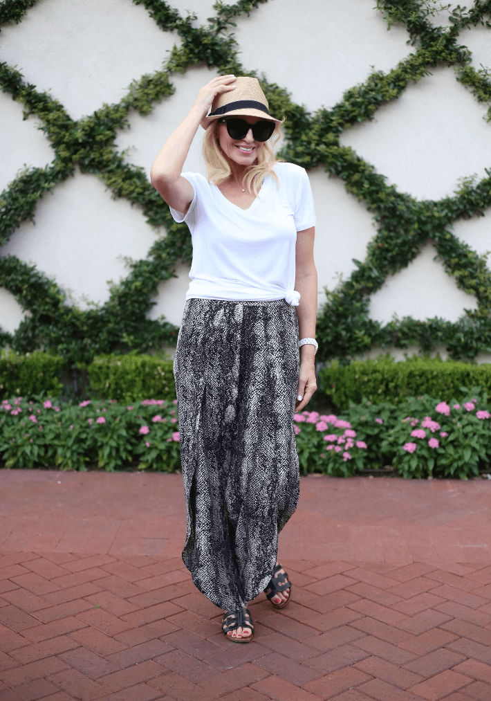 Style blogger Megan Saustad wearing snake print pants, Eric Javits straw fedora, Le Spec Air Heart sunglasses and Sam Edelman sandals.