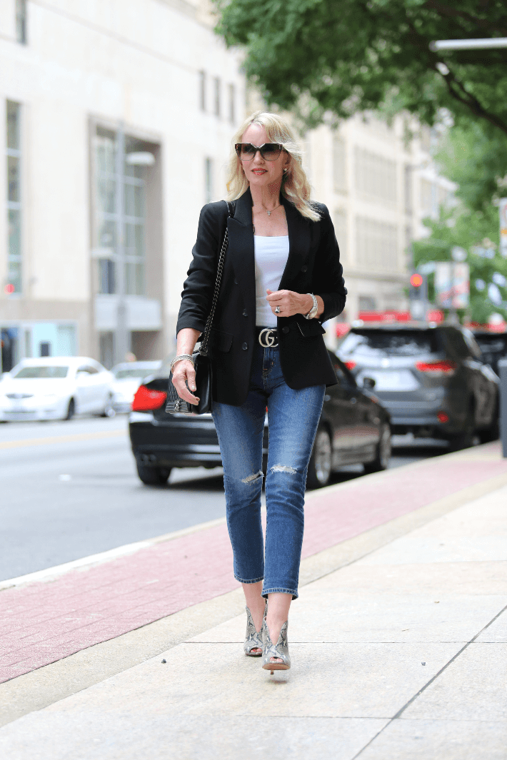 Dallas fashion blogger wearing black blazer, boyfriend jeans, Gucci belt and snake skin booties.