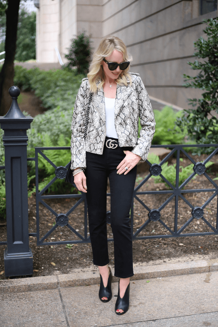 Dallas style blogger wearing BlankNYC Snake Print Moto Jacket, Gucci Belt and Halogen Rowen Booties.