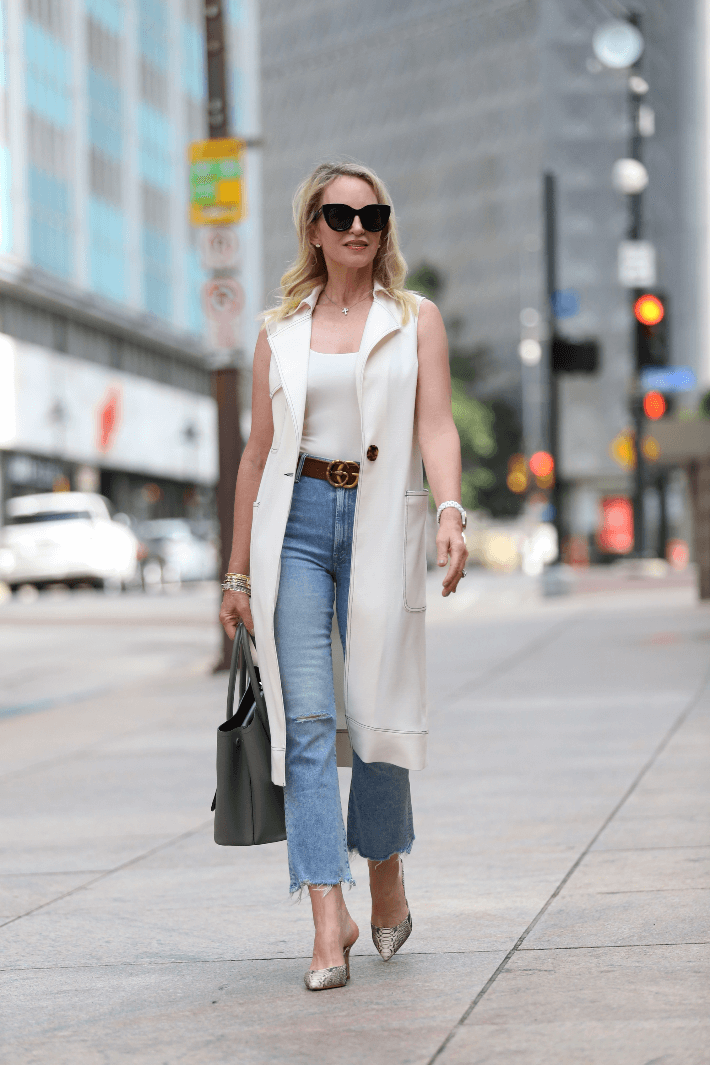 Dallas fashion Megan Saustad wearing Mother Jeans, Topshop Duster, Gucci Belt and wearing Le Specs Air Heart Sunglasses.