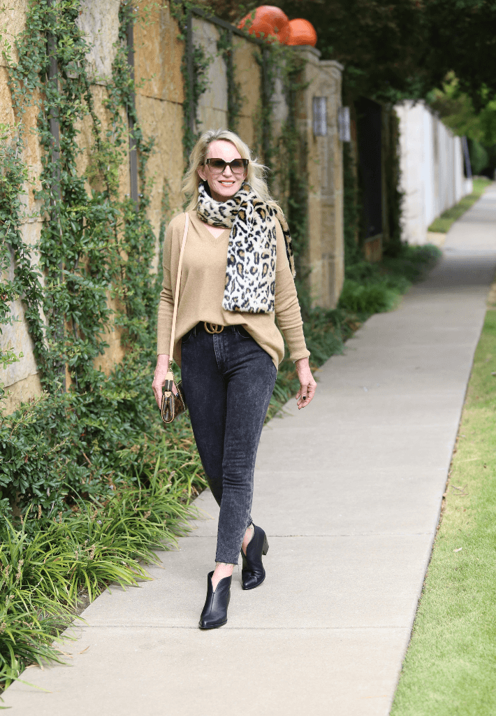 Dallas blogger Megan Saustad wearing J. Crew camel cashmere sweater, Frame jeans, Worth leopard print scarf and Vince Havana booties.