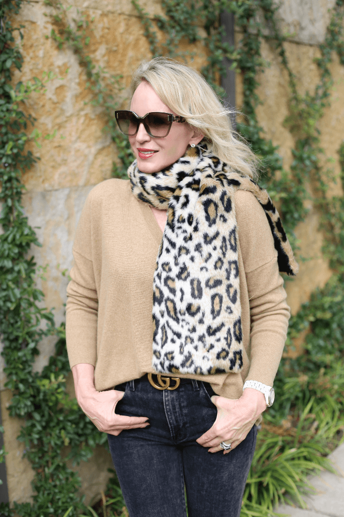 Dallas style blogger Truly Megan wearing J. Crew cashmere camel sweater, Worth Collection leopard print faux fur scarf and Gucci belt.
