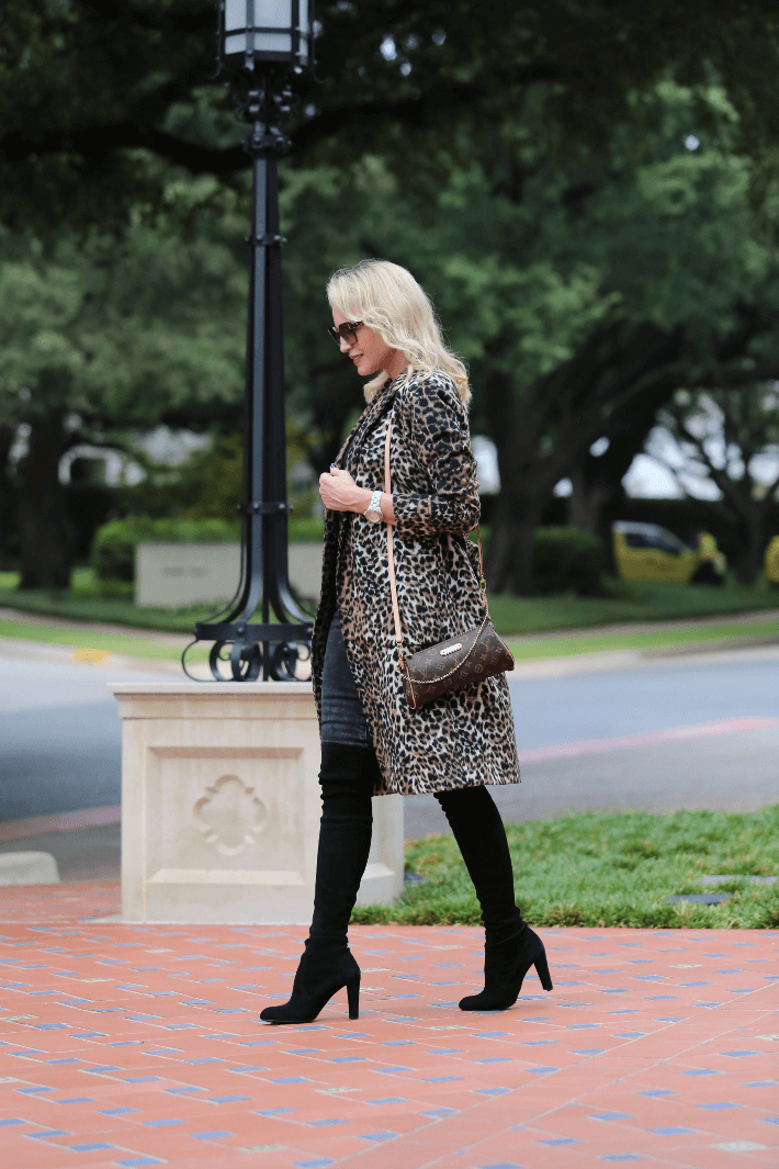 Dallas blogger Megan Saustad wearing a W by Worth leopard coat, Stuart Weitzman over the knee black suede boots and carrying Louis Vuitton Eva handbag.