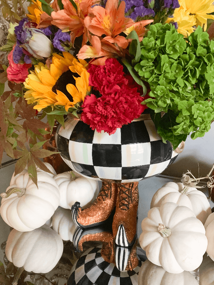 Lifestyle blogger Truly Megan has the Mackenzie Childs Courtly Checked Cauldron on display filled with fresh fall flowers.