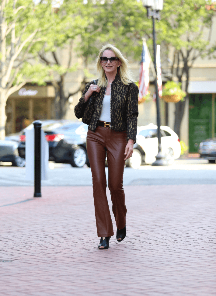 Dallas blogger Megan Saustad wears W by Worth faux leather pants and leopard bomber jacket.