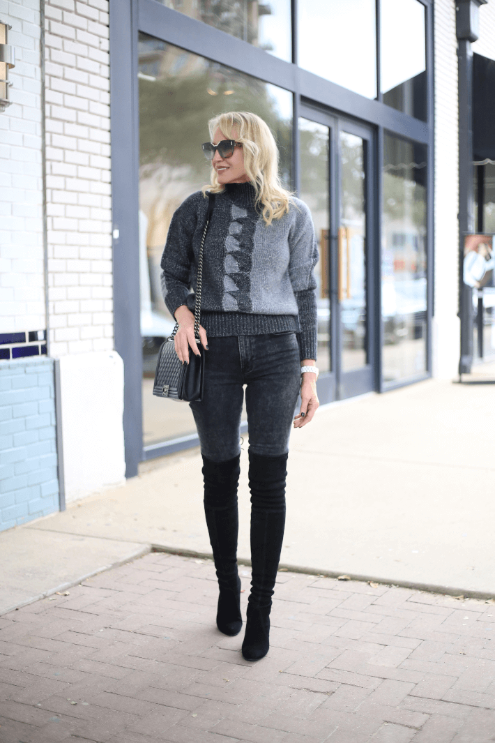 Dallas style blogger Megan Saustad wearing W by Worth intarsia cable sweater, Frame acid wash jeans, Stuart Weitzman suede over the knee boots and carrying Chanel Boy Bag