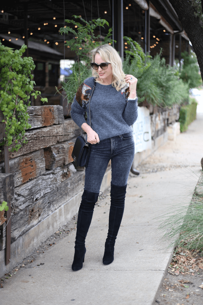 Dallas blogger Megan Saustad wearing W by Worth sequin pullover, Frame jeans, Stuart Weitzman suede over the knee boots and carrying Chanel Boy Bag.
