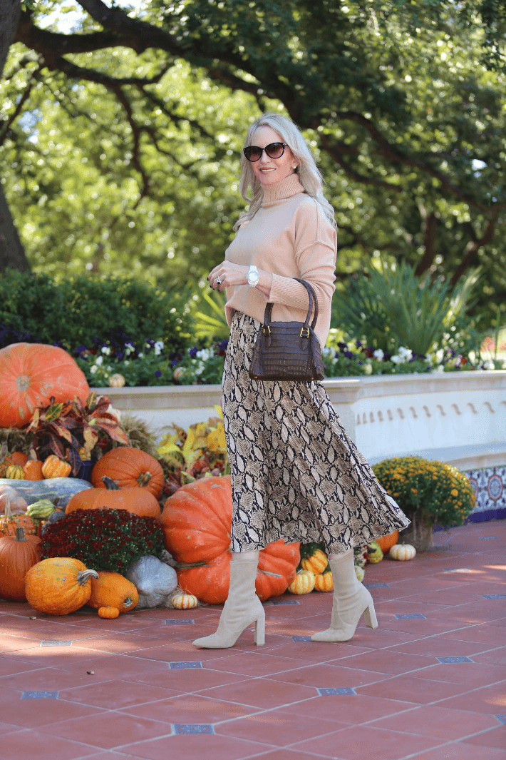 Dallas blogger Truly Megan wearing Chicwish snake print pleated midi skirt, tan sweater, Stuart Weitzman booties and Tom Ford sunglasses.