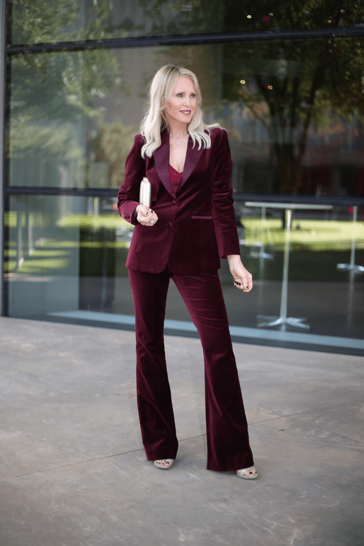 Dallas fashion blogger wearing burgundy velvet pant suit by The Worth Collection.