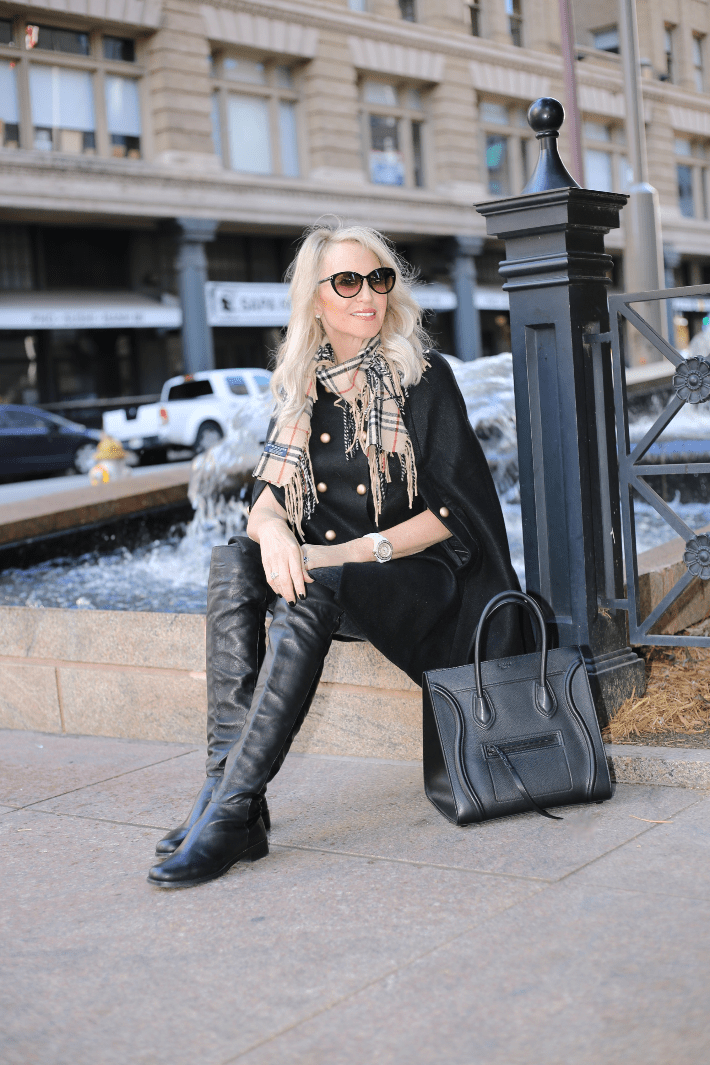 Dallas blogger wearing Chicwish black cape, Stuart Weitzman over the knee boots, Burberry scarf and carrying Celine Phantom handbag.