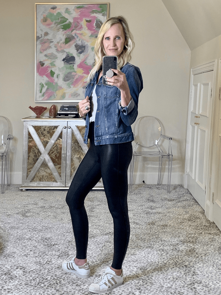 Dallas lifestyle blogger Truly Megan wearing spanx faux leather legging and denim jacket.
