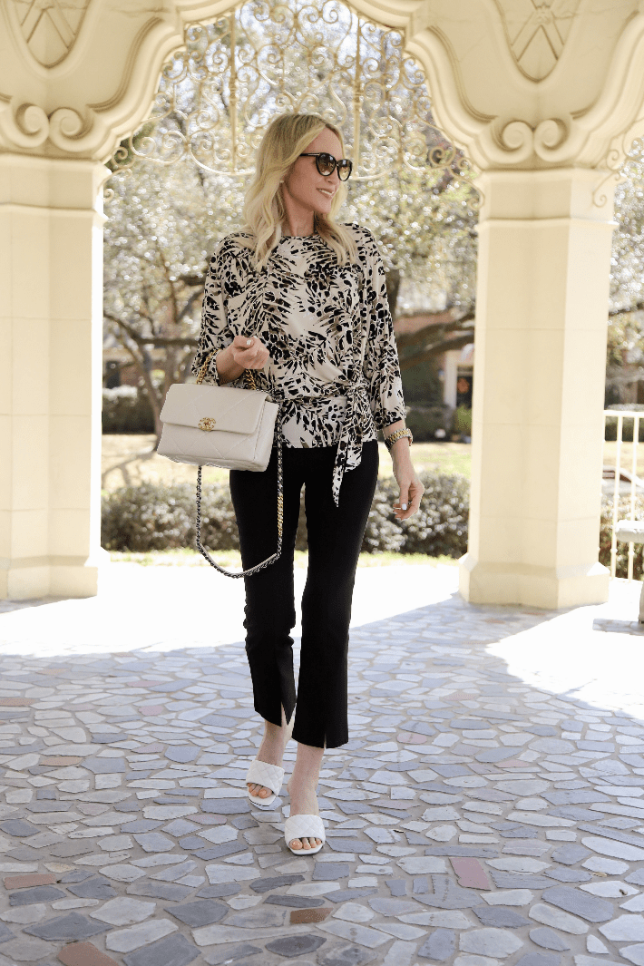 Dallas blogger Truly Megan wears Clara Sunwoo Palm Animal Print Top and Center Front Seam Ankle Pant.