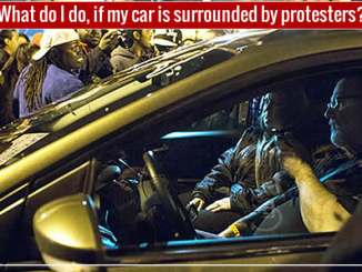 protesters surround your car