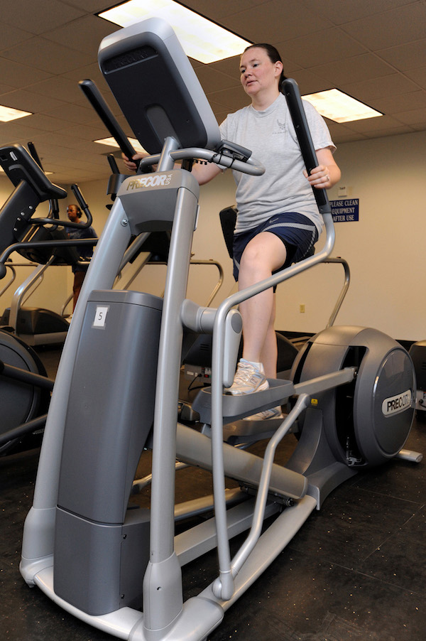 A woman working out on an elliptical