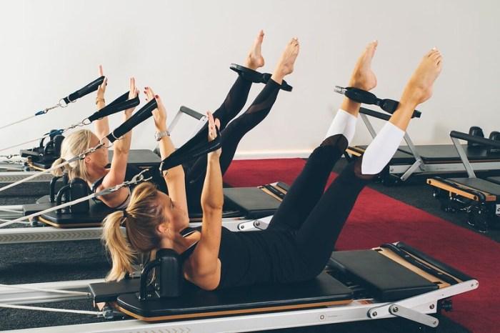 Women doing pilates on reformer