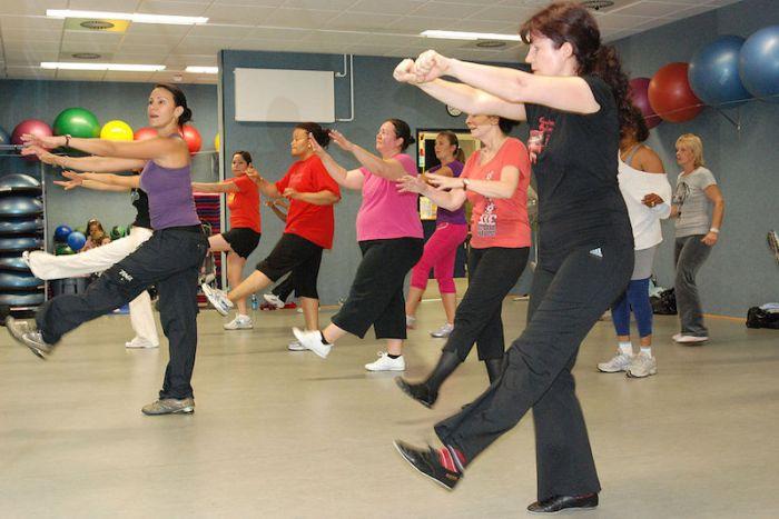 Class of women doing zumba exercise