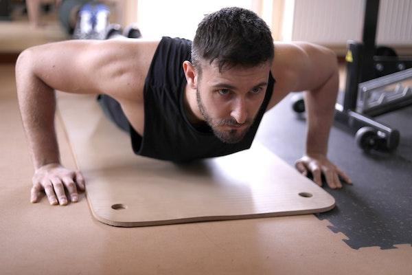 Man doing push ups on gym floor