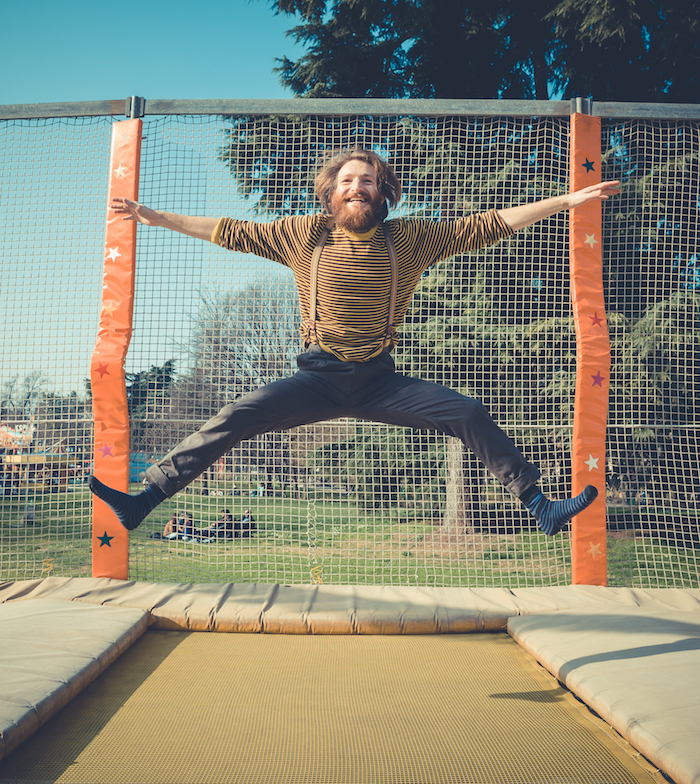 Man jumping excitedly on trampoline