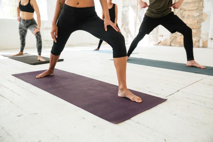 Women posing in yoga class