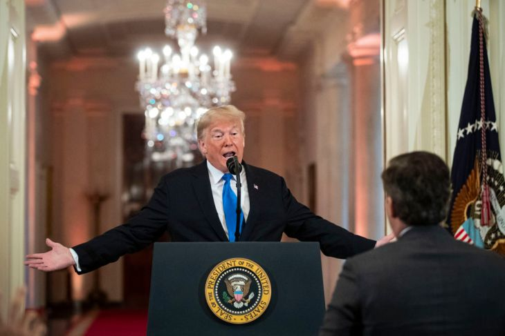 Donald Trump gets into an exchange with CNN reporter Jim Acosta during a news conference a day after the midterm elections on November 7, 2018, in the East Room of the White House in Washington, DC.