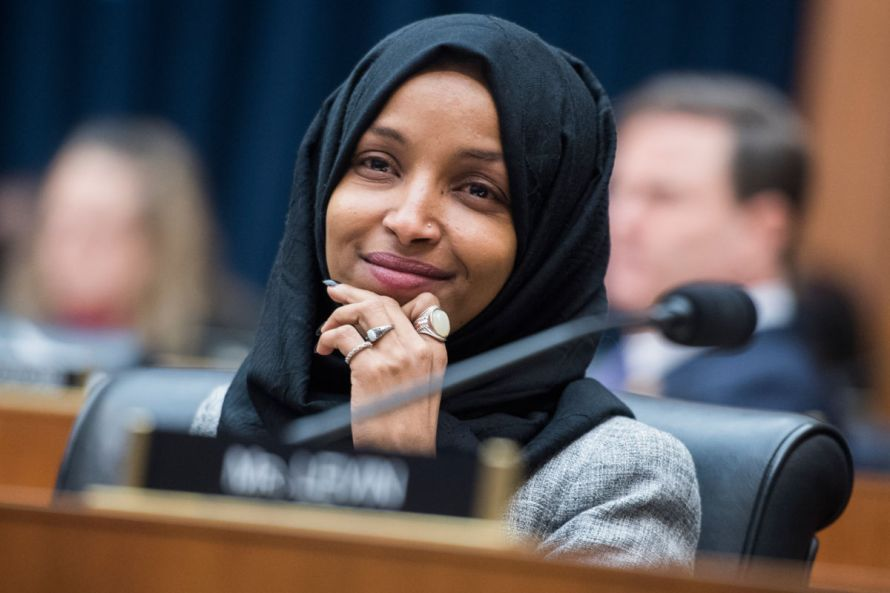 Rep. Ilhan Omar listens during Congressional meeting