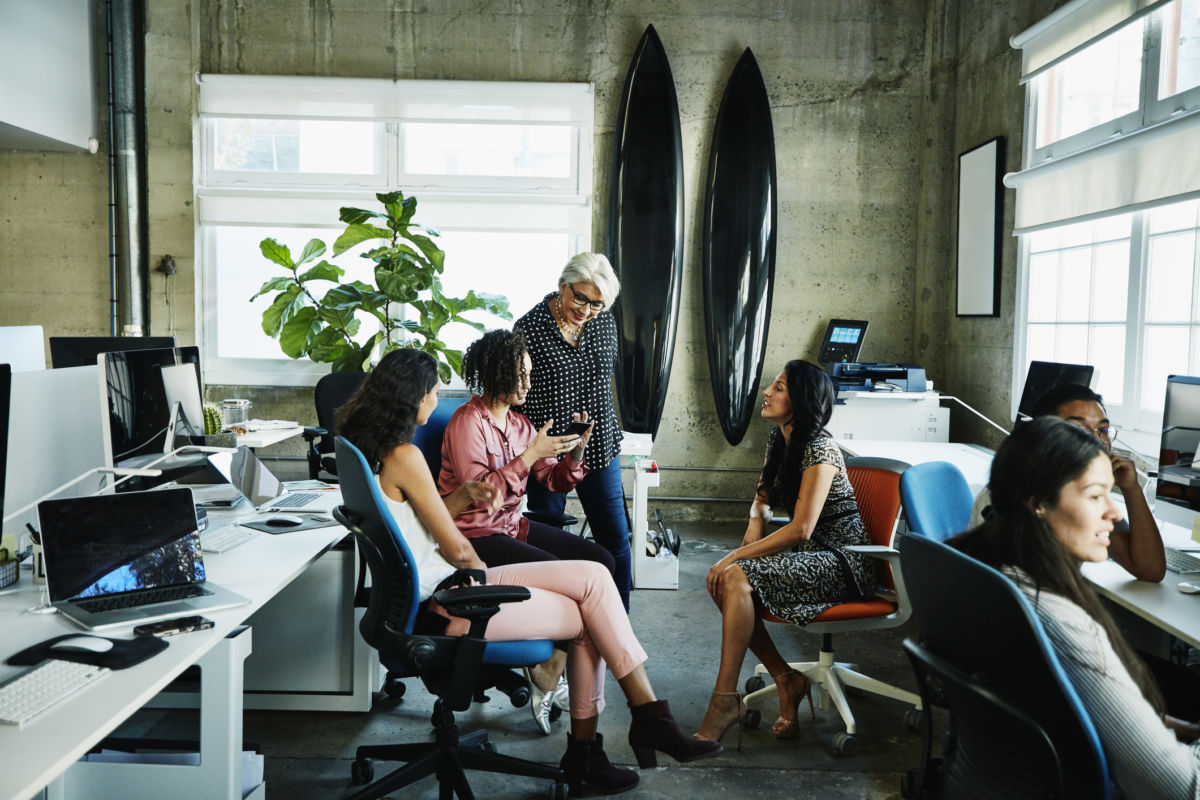 A group of women have a meeting in an office