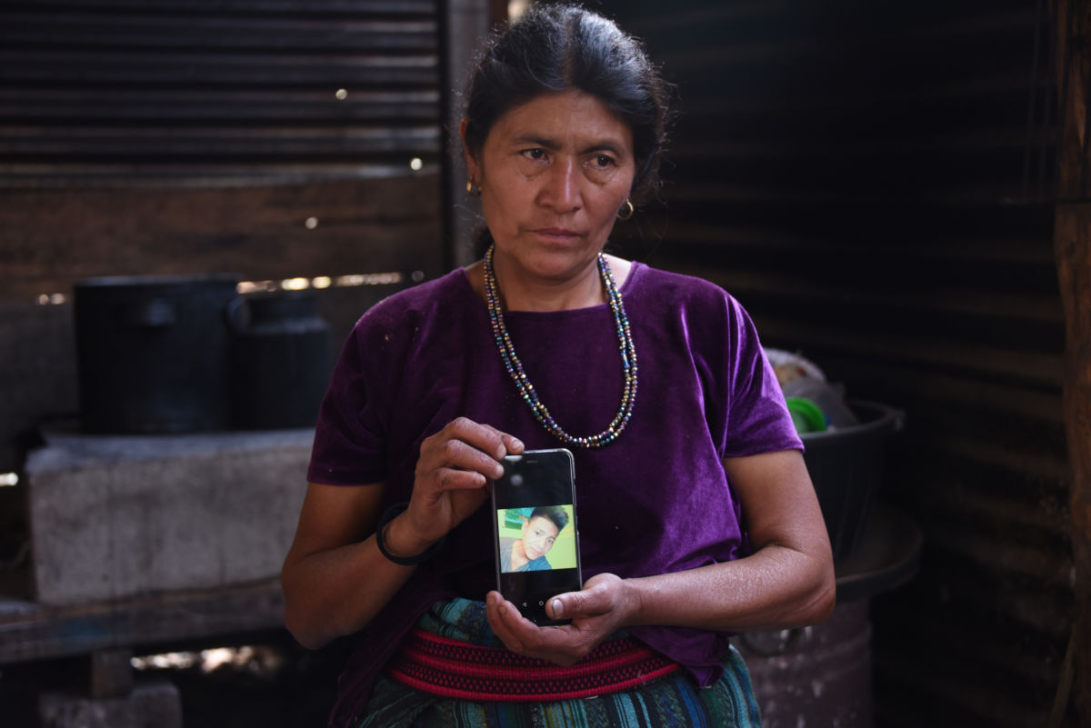 Rigoberta Vasquez, mother of sixteen-year-old migrant Carlos Hernandez Vasquez, who died Monday at a Border Patrol in Texas, shows a picture of her son on a mobile phone outside her house in San Jose El Rodeo village, Cubulco municipality, Baja Verapaz department, northwest of Guatemala City on May 22, 2019.