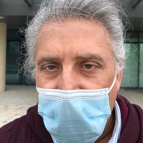Photo of Executive Editor, British Medical Journal Kamran Abbasi wearing a COVID mask