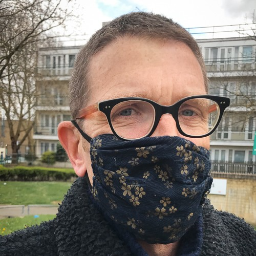 Photo of Guardian reporter Mattew Weaver wearing a COVID mask