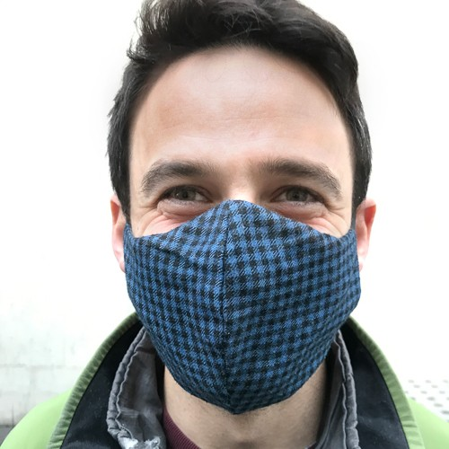 Photograph of Analyst Nick Waters wearing a COVID mask