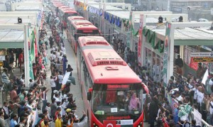 People celebrating inauguration of Metro Bus system in Lahore,Photo:The News International