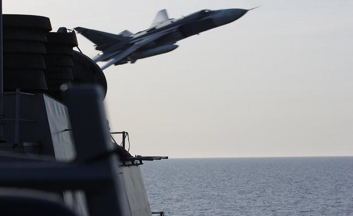 An U.S. Navy picture shows what appears to be a Russian Sukhoi SU-24 attack aircraft making a very low pass close to the U.S. guided missile destroyer USS Donald Cook in the Baltic Sea in this picture taken April 12, 2016 and released April 13, 2016. REUTERS/US Navy/Handout via Reuters