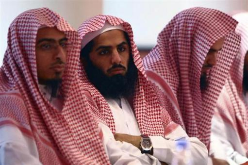 Members of the Committee for the Promotion of Virtue and Prevention of Vice, or religious police, attend a training course in Riyadh April 29, 2009 . REUTERS/Fahad Shadeed (SAUDI ARABIA MILITARY RELIGION)