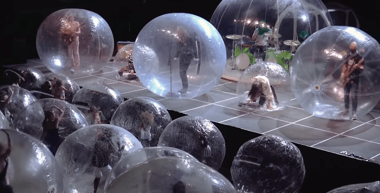 The Flaming Lips and their fans encased in bubbles during concert