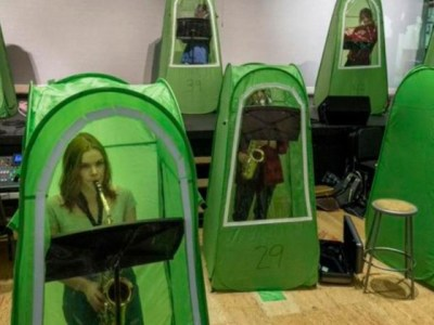 Band students practice in isolated, enclosed tents
