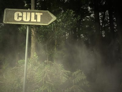 Sign pointing to a nearby cult