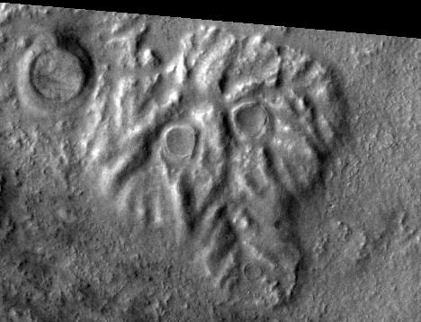 А что это за чудище или череп - тоже не беремся комментировать без специалиста. Глаза - ударные кратеры, а остальное?