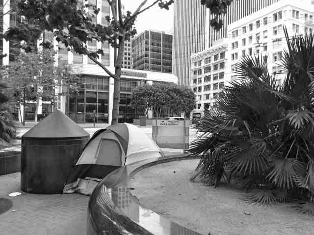Homeless person camping in a tent on the streets of San Francisco