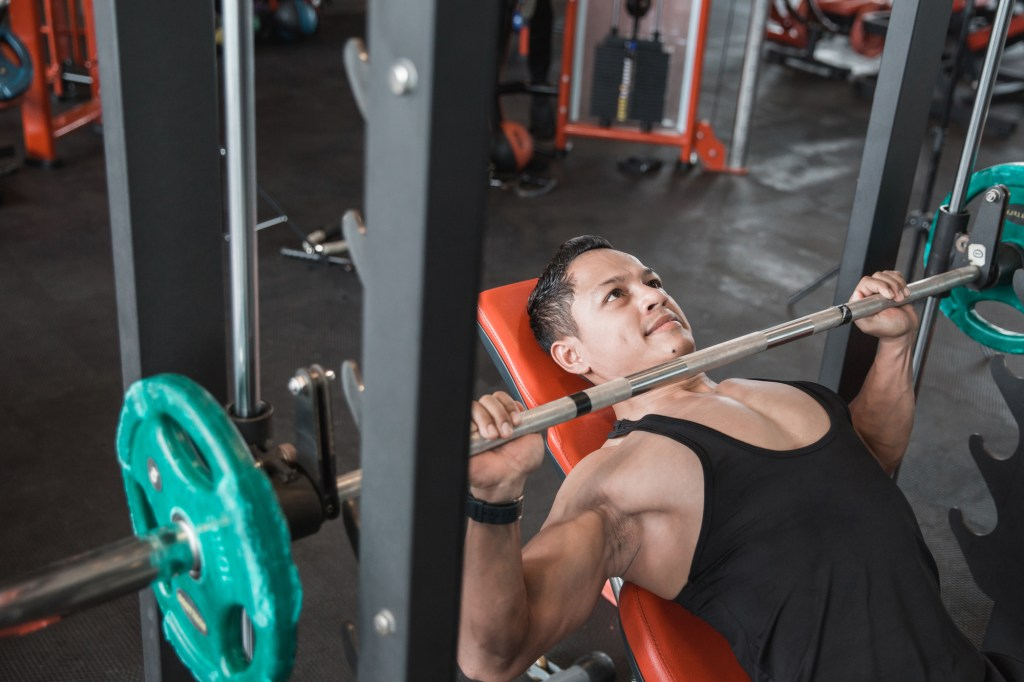 Should You Bench Press with a Smith Machine or a Barbell