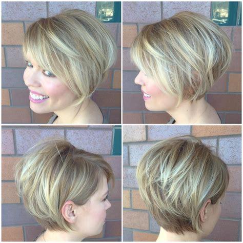women blonde stacked bob side swept bangs highlights