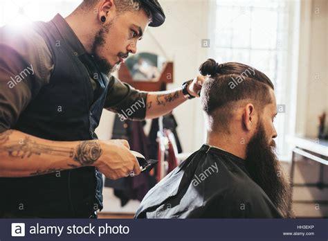 stylish hairdresser cutting hair client barber shop beard