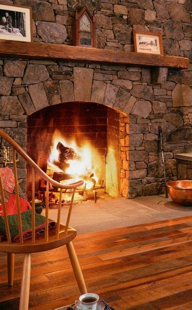 floor level stone fireplace wooden mantle