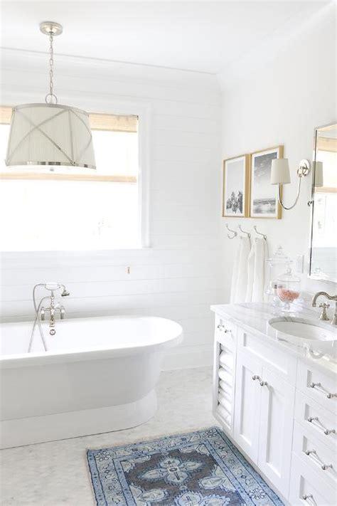 white bathroom blue bath mat transitional