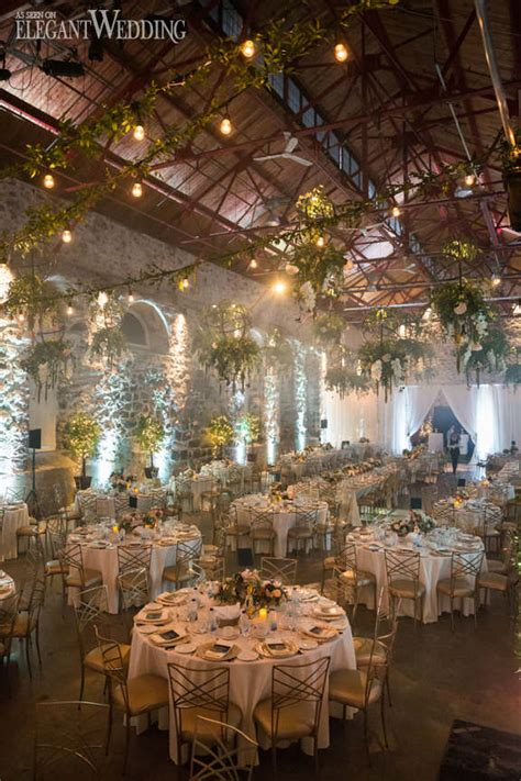industrial wedding hanging greenery elegantwedding